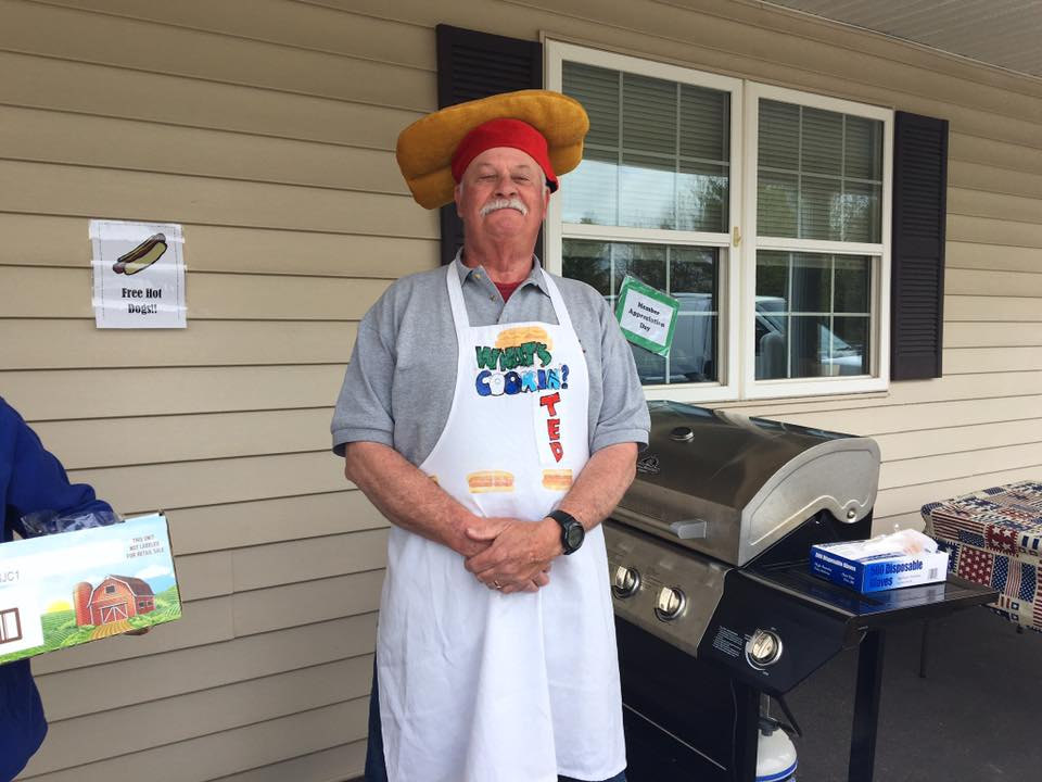 man standing by the grill