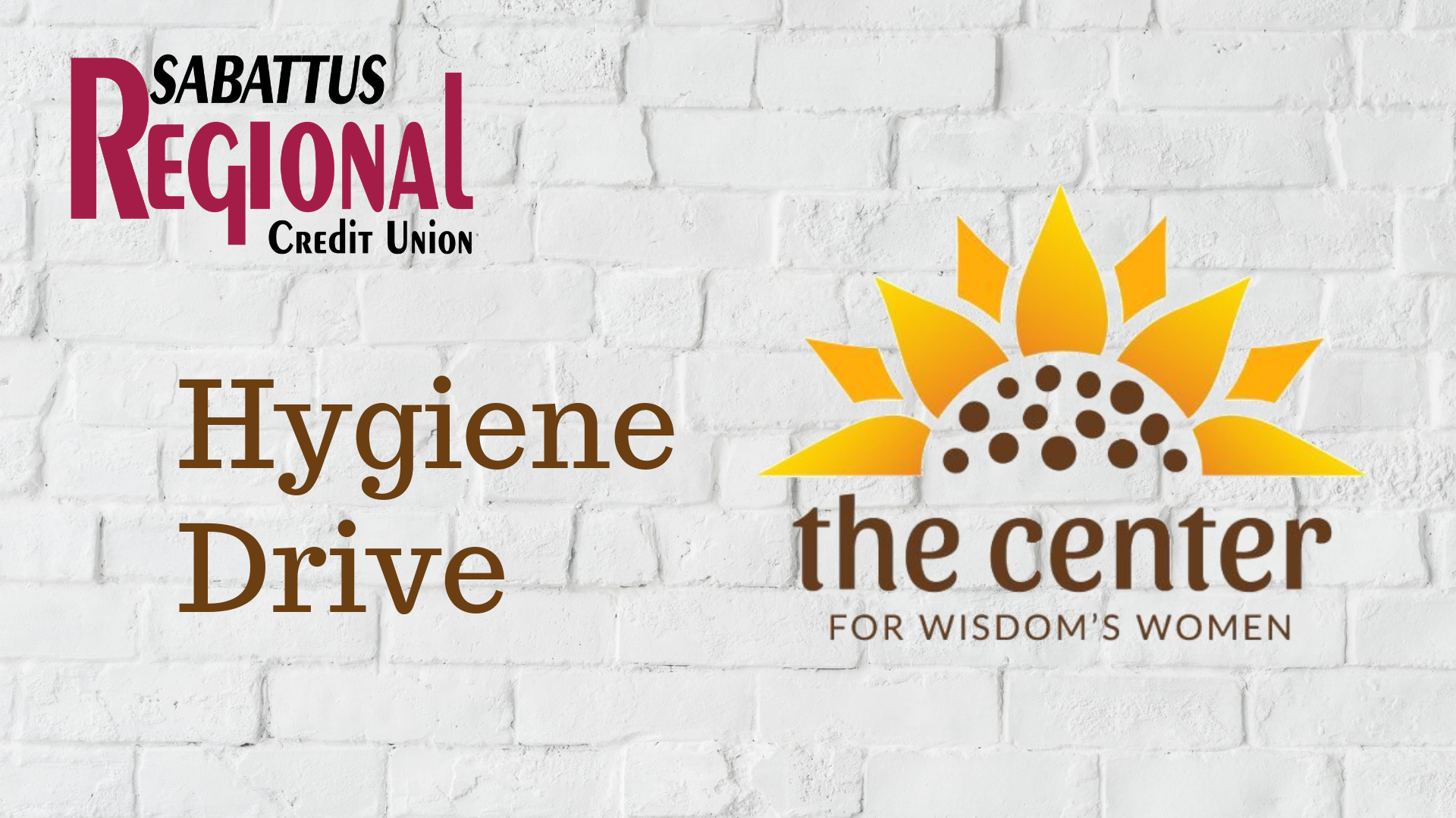 """a brick wall with the SRCU log and the Center for Wisdom's Women logo with text saying """"Hygiene Drive"""""""